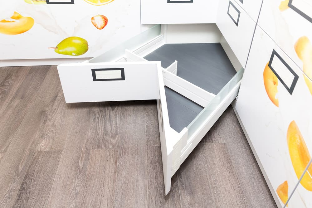 Clever kitchen cabinet corner drawer design
