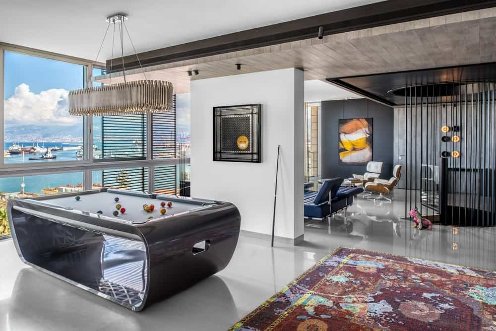 Game room in large bright condo with super modern billiards table.