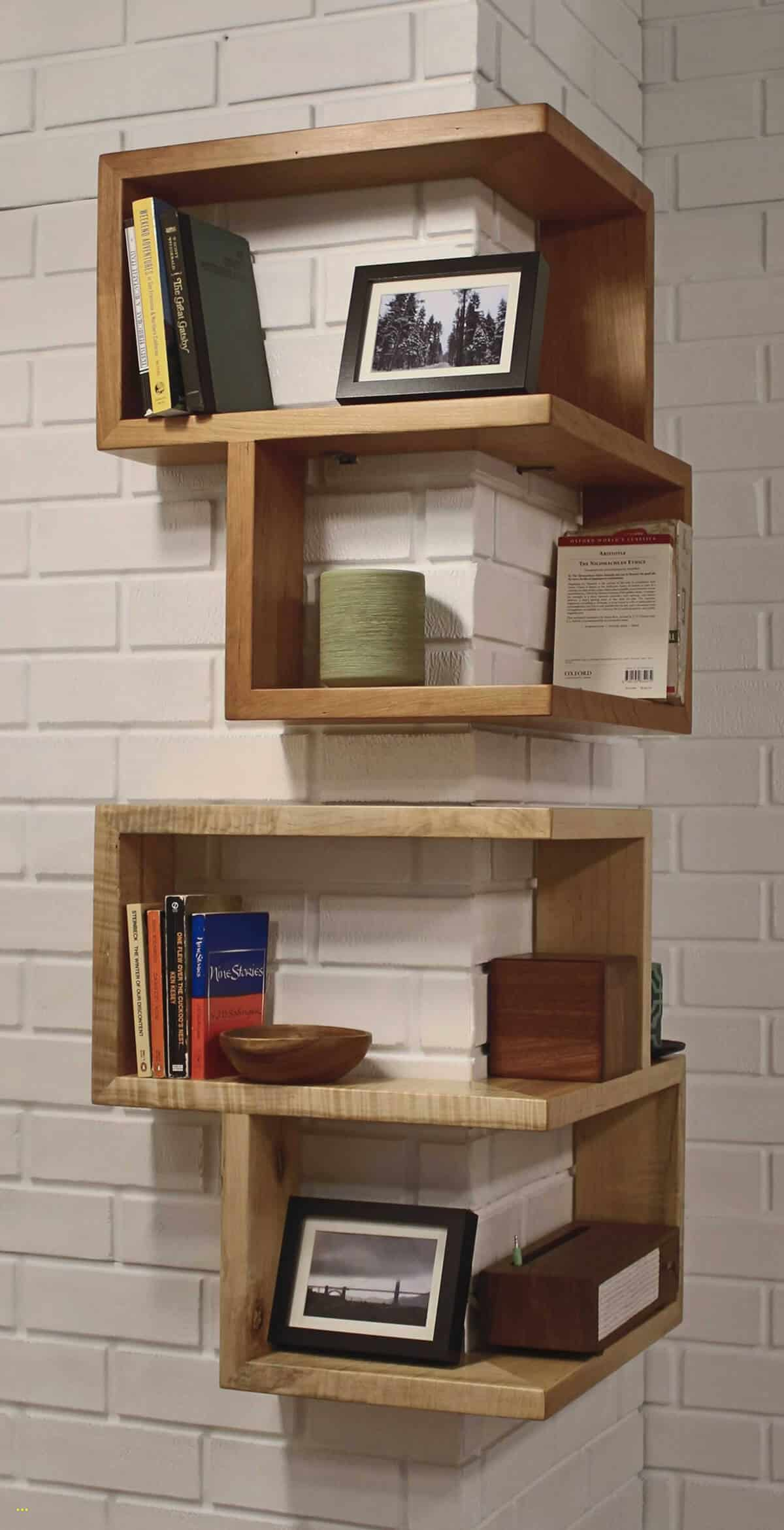 Outward corner floating geometric wood shelving works great on these hard-to-use corner areas