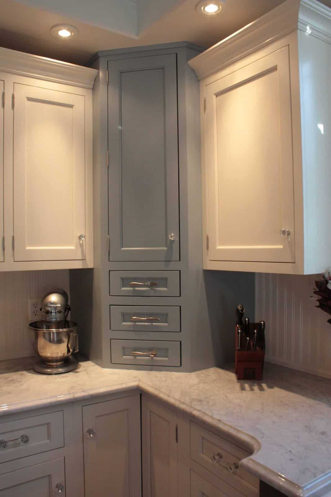 Here's a towering countertop to ceiling cabinet with drawers and cupboard.