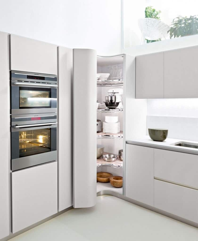 If you like the modernstyle, here's a curved tall corner storage unit in the corner of a kitchen.
