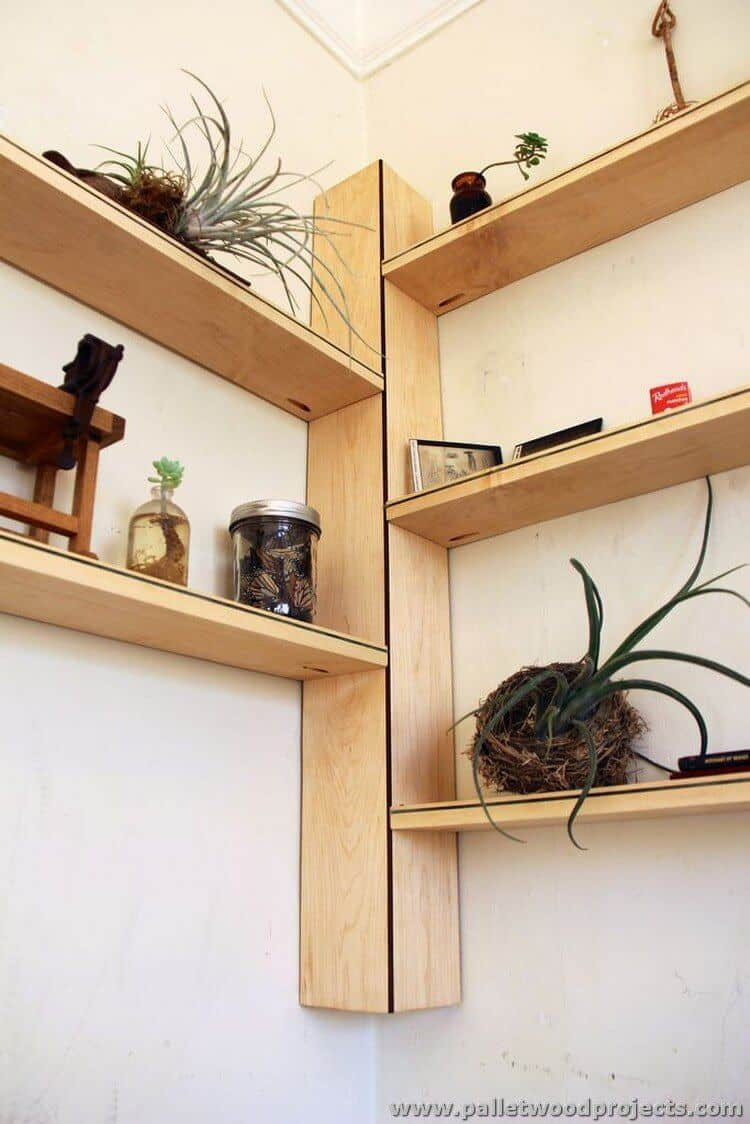 Have a pallet kicking around?  Turn it into a corner floating shelving unit like this