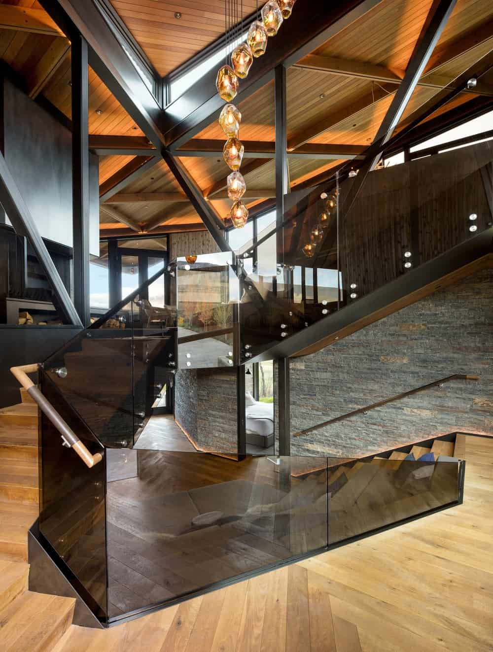 Foyer and staircase with black glass balustrade
