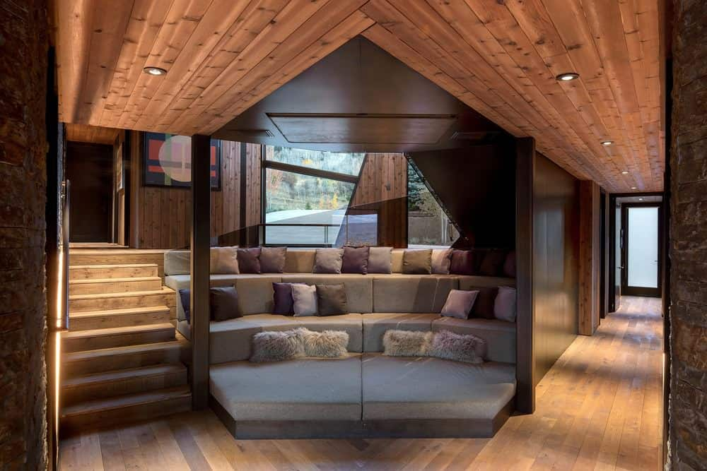 Awesome TV viewing room with tiered seating in nook of house