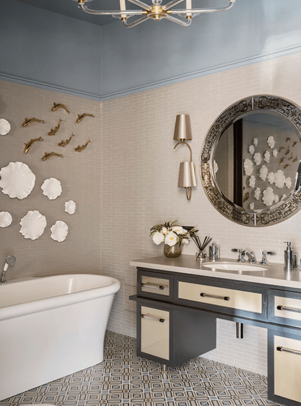 Kids bathroom with clouds and fish on wall above the white tub in Russian mansion