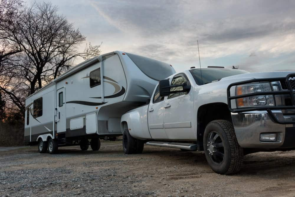 Pickup truck with 5th wheel trailer.