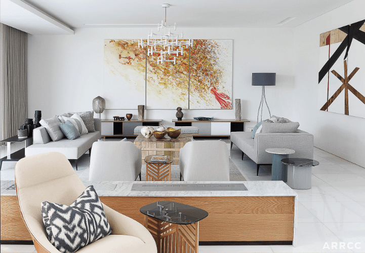If you want a modern living room design that's slightly more urban, this is a great example. Natural light and a modern color scheme are present but are made more personal with the addition of comfy cushions and plenty of art and plants. This makes for a really trendy, urban finish.