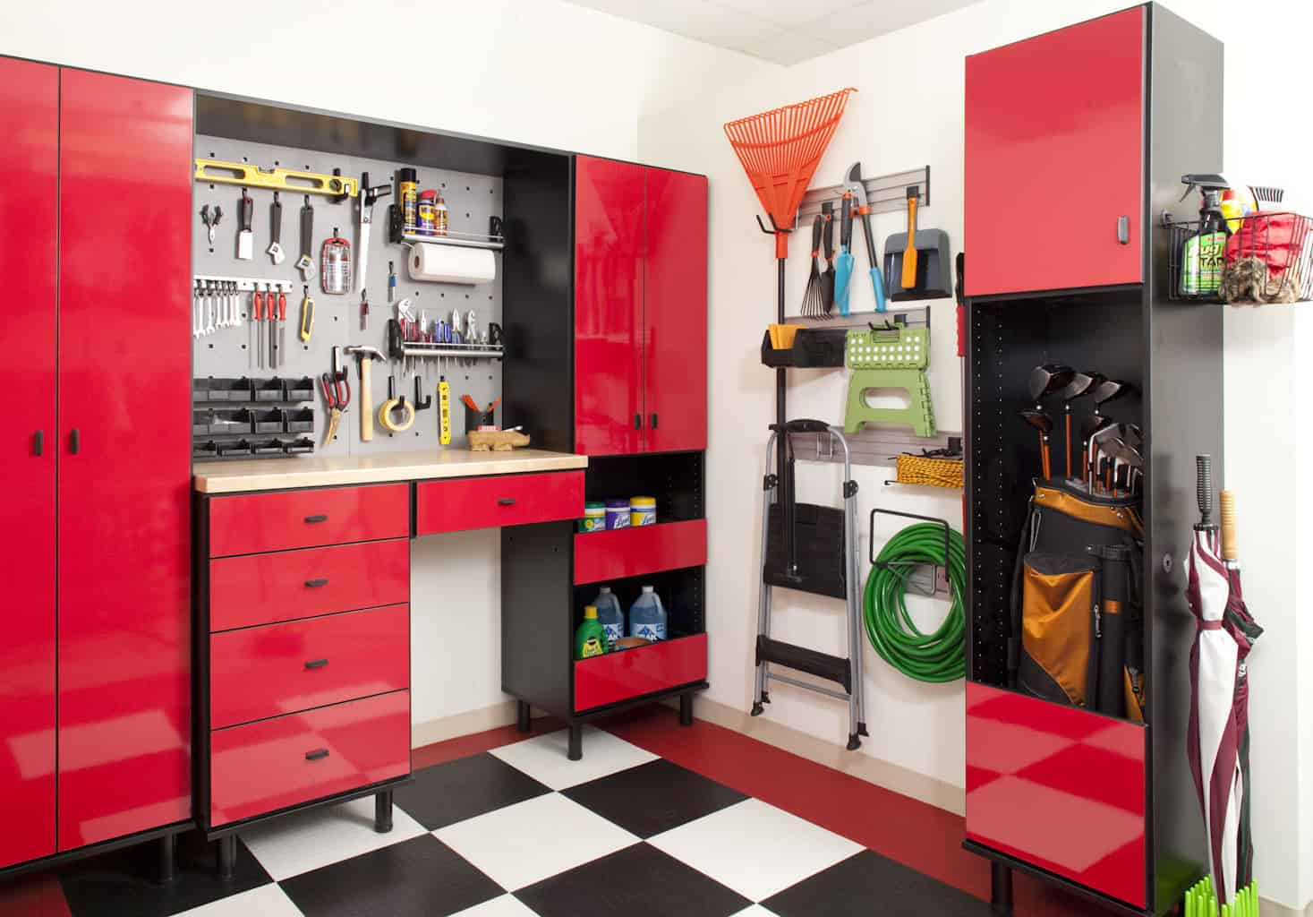 I sure wish I had this garage storage system. It's a work center and storage system tucked into the corner of the garage with custom black and white checkered flooring.