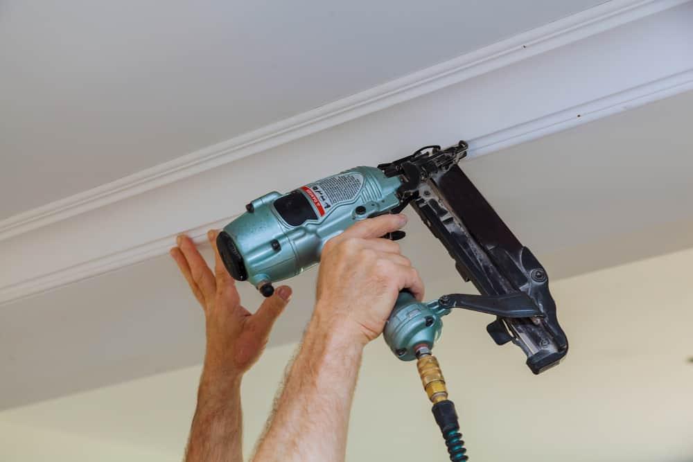 Carpenter putting up crown molding