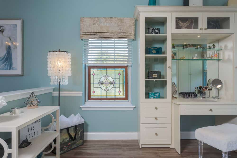 The vanity offers a huge mirror on the wall which is ideal as a makeup application station in this sitting and fitting room off the master bedroom.