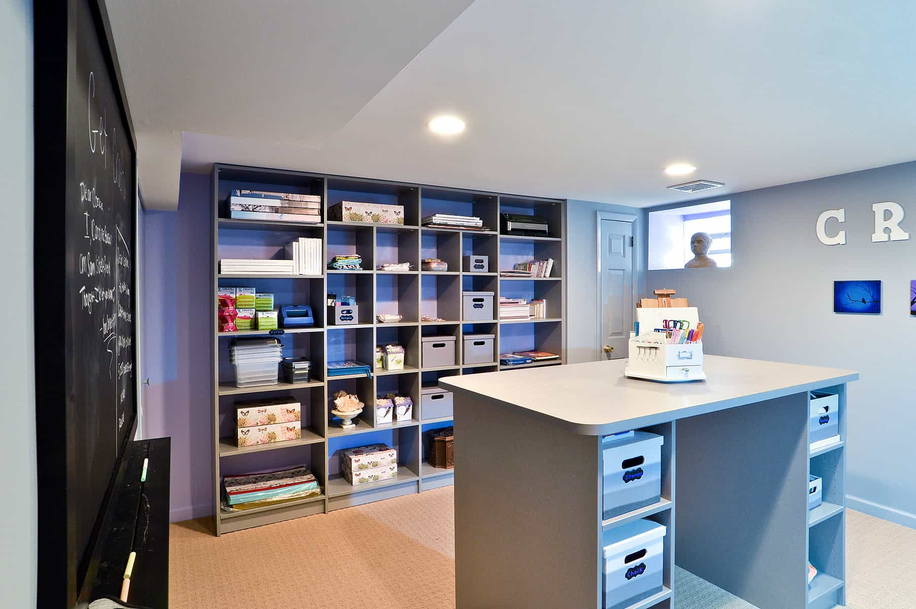 Craft rooms are all the rage as they serve many purposes such as crafts, sewing, office, gift wrapping and more. In today's age of DIY and crafting, more and more homeowners are building craft rooms. This is a beauty with loads of storage by Closet Works.