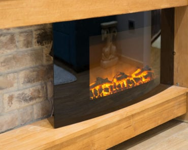 Electric infrared fireplace with mantle in living room