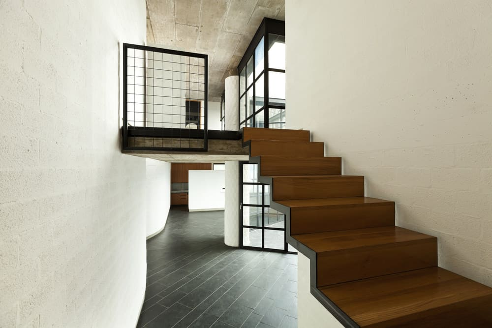 This is not our only floating modern staircase example. You'll notice there's no supports under the upper portion of the steps (tread and risers).