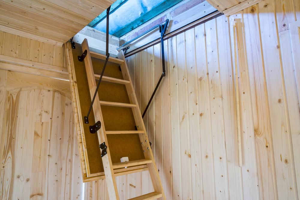 Folding attic ladder stairs for saving space.