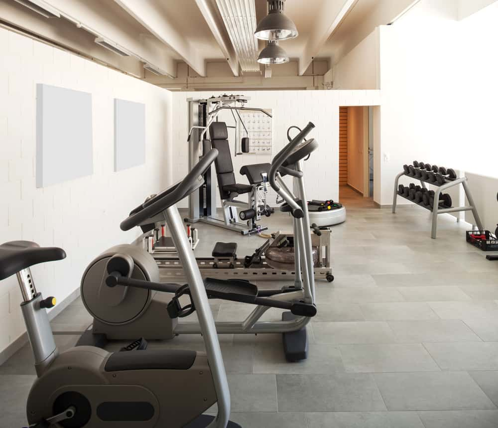 Home gym with cardio and weightlifting equipment.