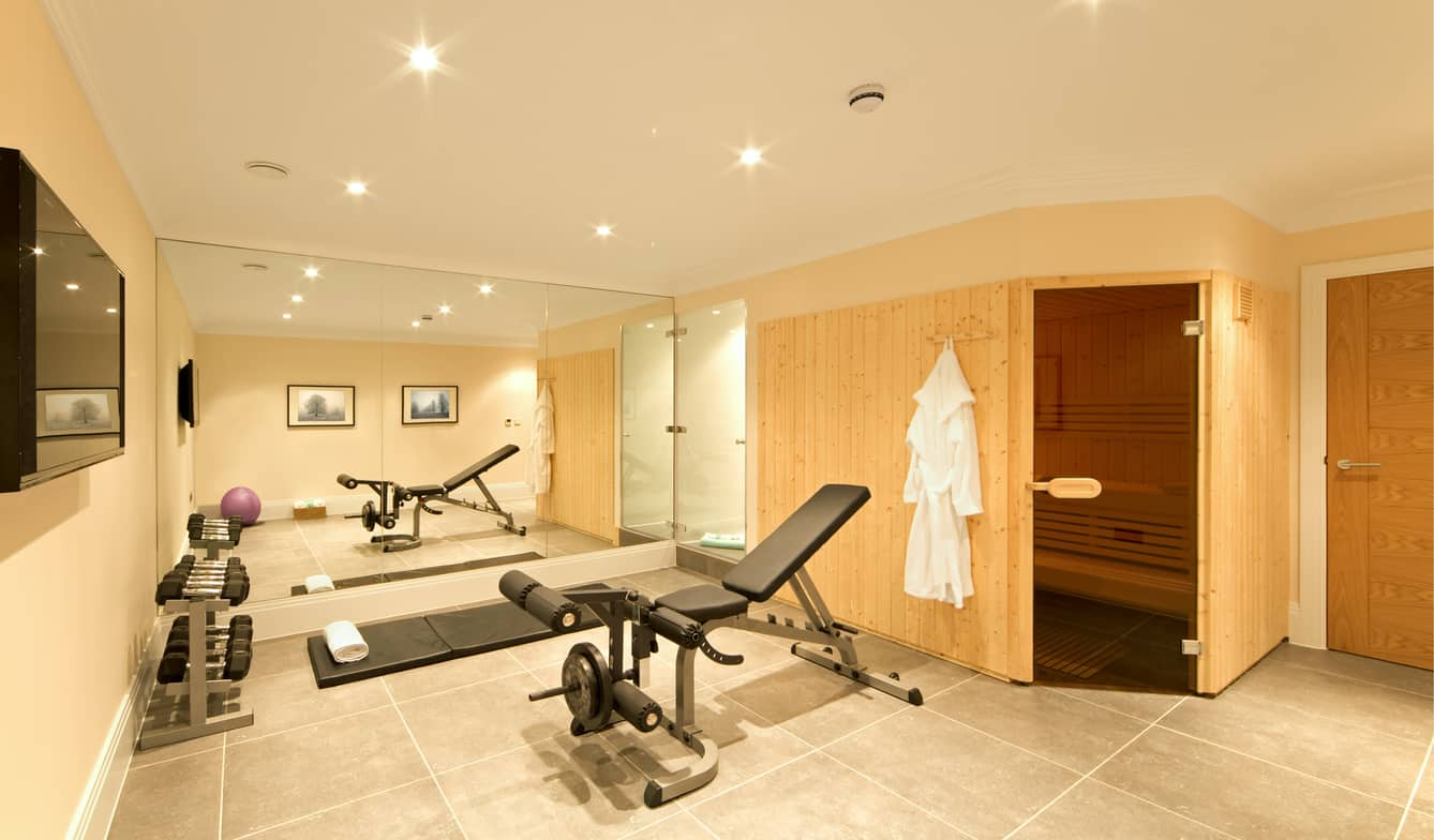 Luxurious home gym with sauna.