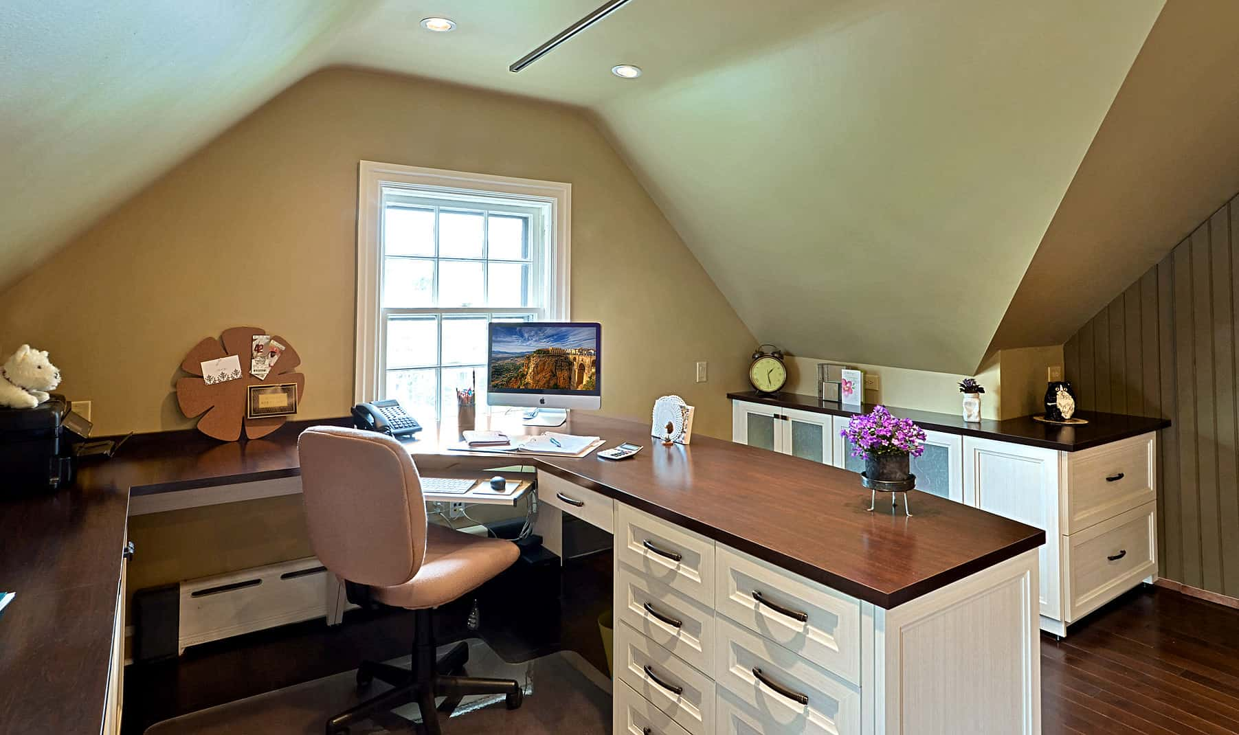 Who says an attic can't be a beautiful home office? Here's an example of how you can turn seemingly unusable attic space into a highly effective and attractive home office.