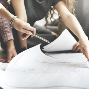 Interior designer showing a client plans