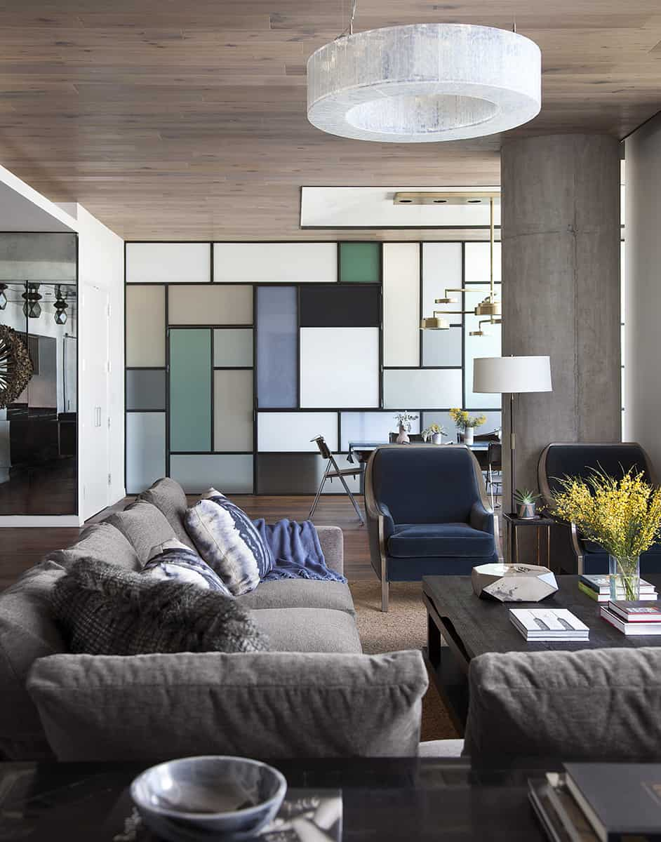 Another view of the living room shows how the opposite wall utilizes a funky, geometric pattern to add some life to a simpler design.