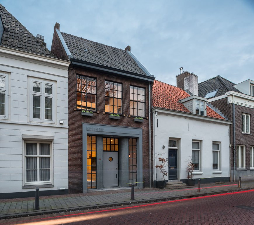 Old brick two story building in European village converted to industrial style townhouse.