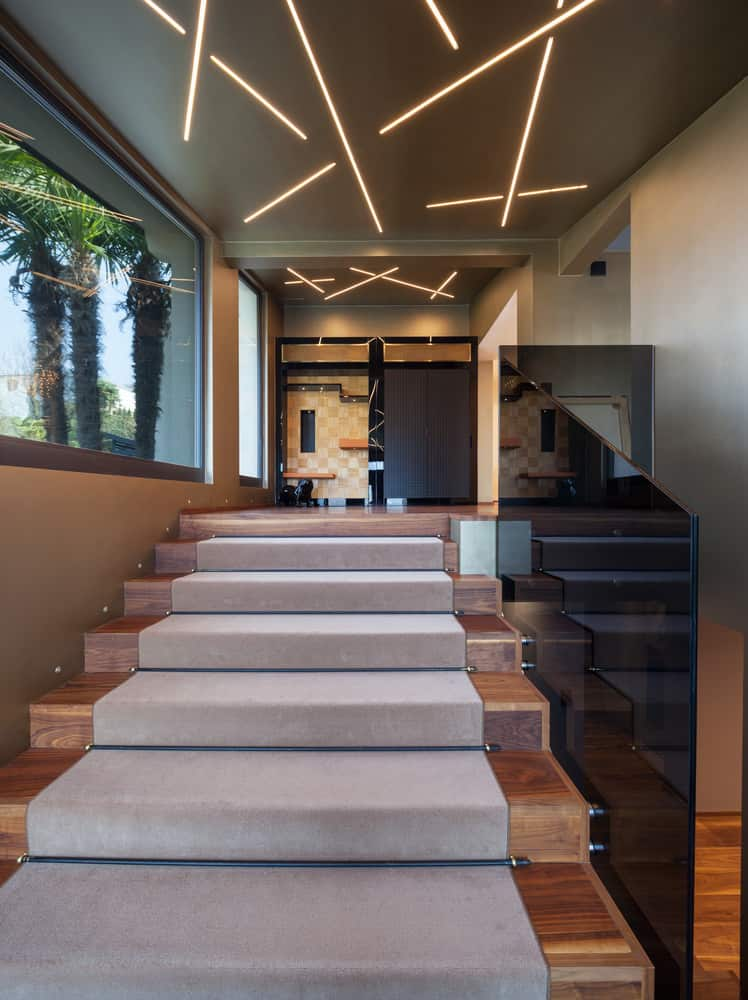 Modern stairs with carpet.