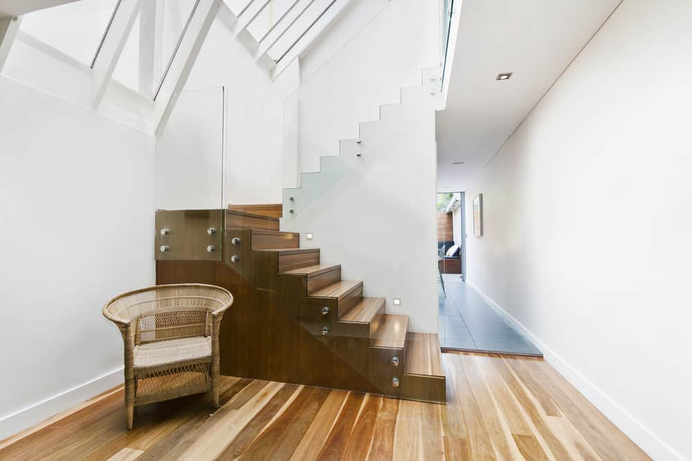 Modern stairs with glass balustrade.