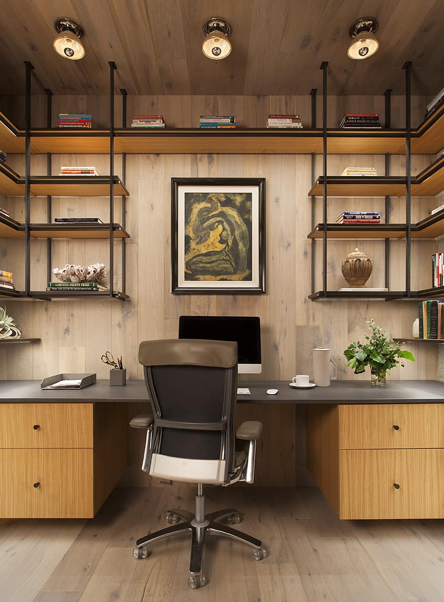 Contemporary meets industrial home office with wide desk and loads of open floating metal and wood shelving