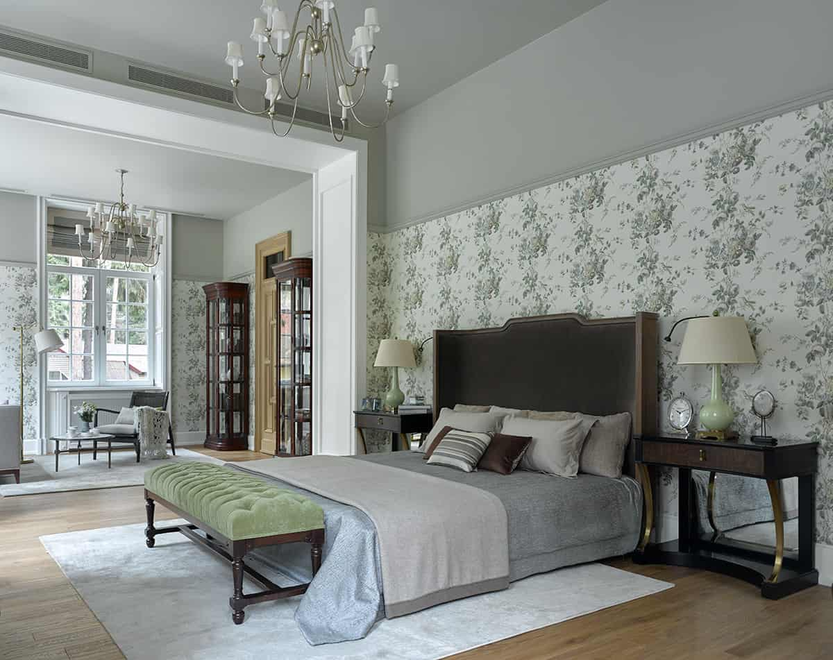 The subtle green hints in the interiors add freshness to the room. Do you love your classic bedroom but are bored with the bland color scheme? Then you can add hints of green to add liveliness. Take inspiration from this design and add floral wallpaper, light green bedside lamp and a plush green ottoman at the foot of the bed.