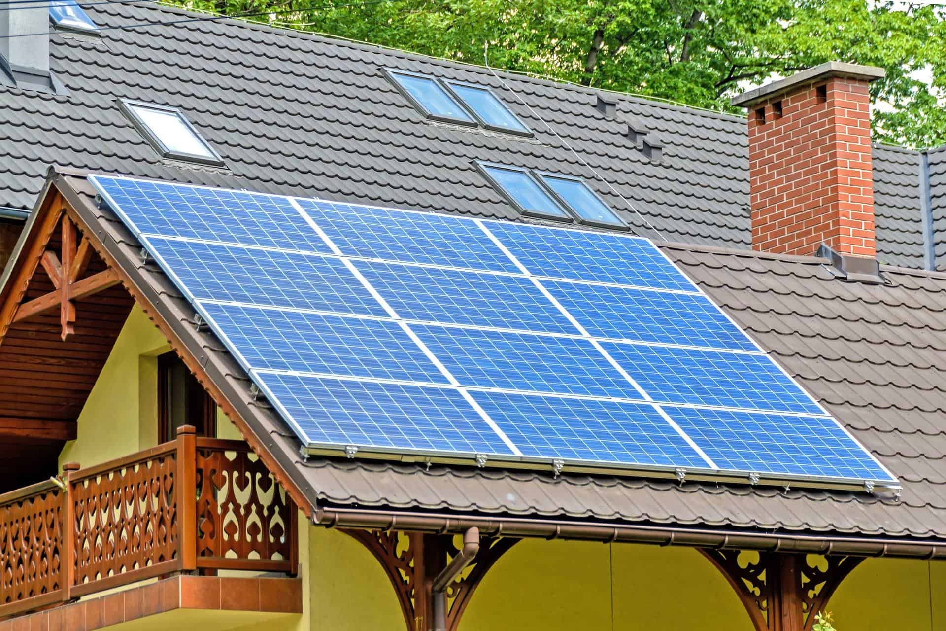 Photograph of solar panels on the roof of a suburban home