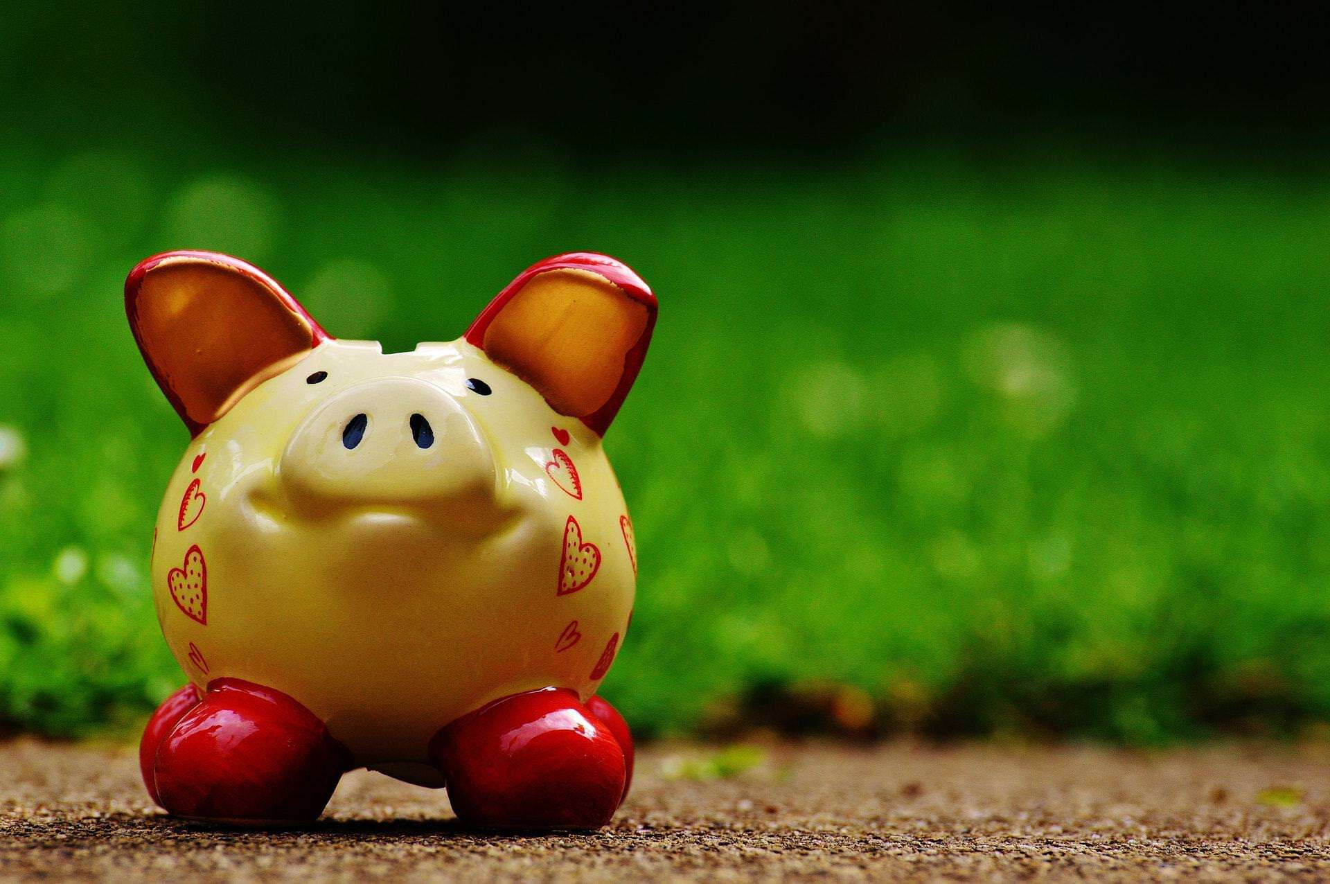 Piggy bank used as a metaphor for saving money from investing in a solar system