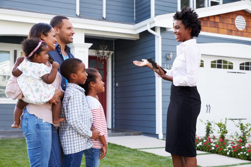 Real estate agent showing a family a new home