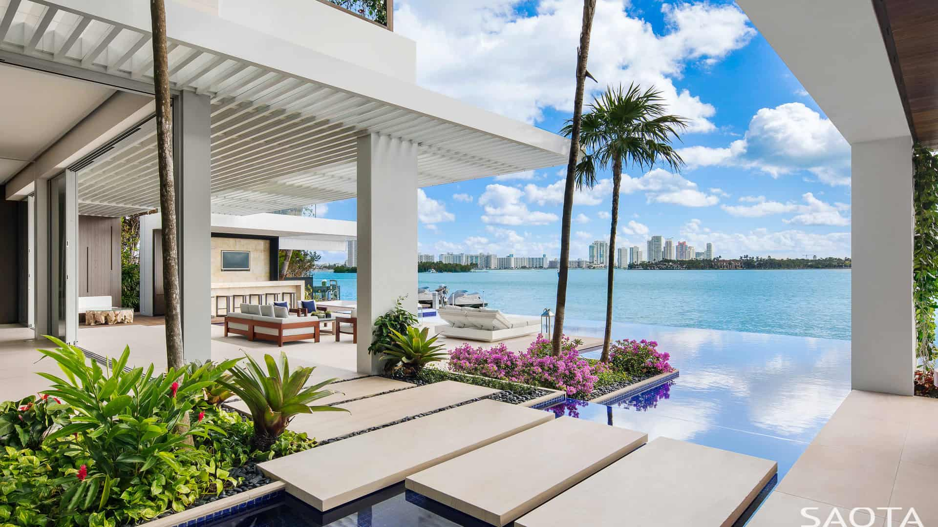 This modish poolside patio offers a great seats and view to the city's river.