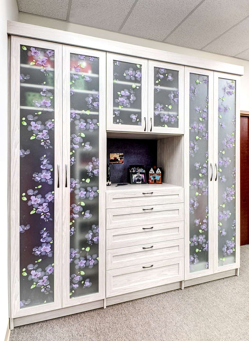 Wardrobe and dresser design by Closet Works.