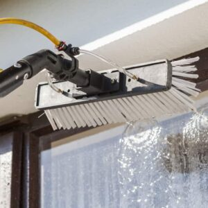 Window washing bruch with hose attachment