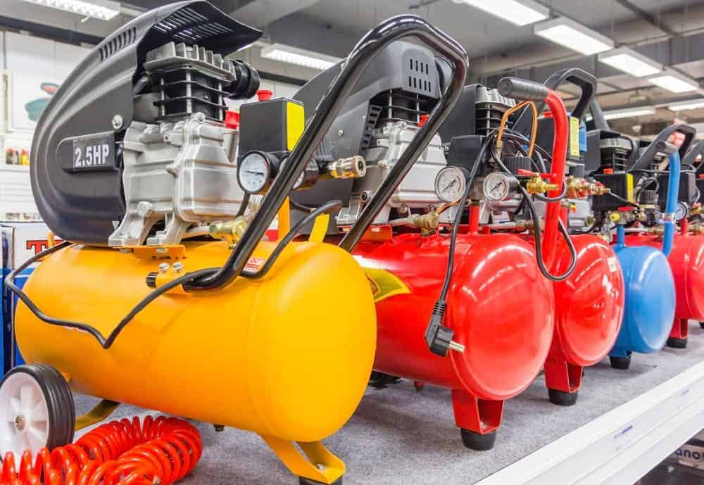 Colorful air compressors on display.