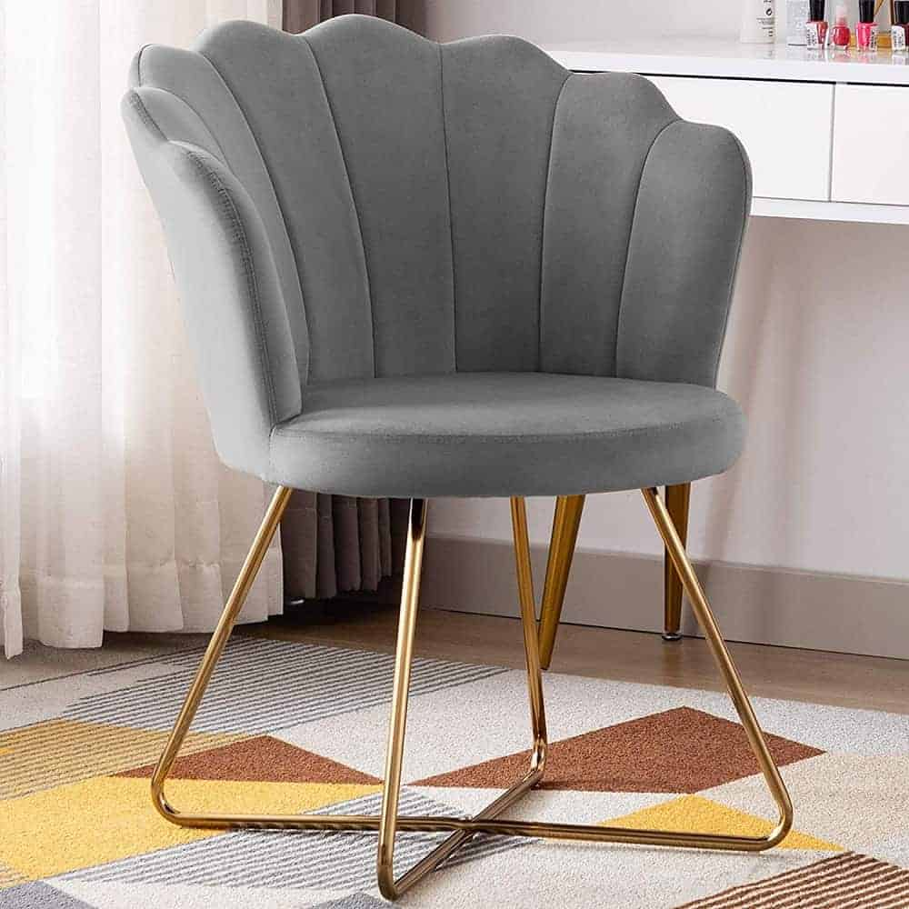 The Duhome Accent Chair with tufted cushion and golden legs from Amazon.