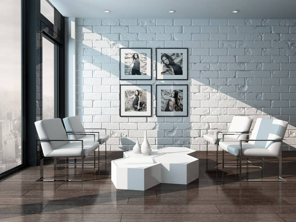 Modern living room with whitewashed brick wall.