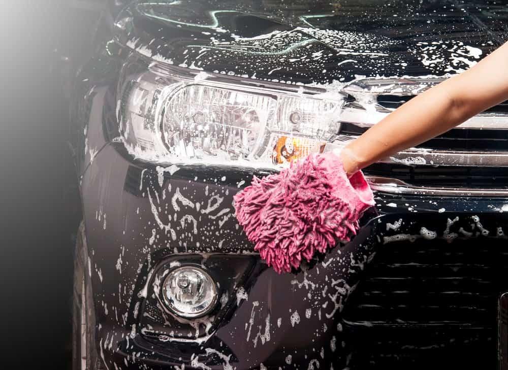 Car wash mitt used to wash a car.