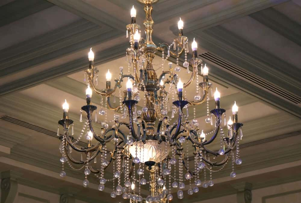 Chandelier on coffered ceiling.
