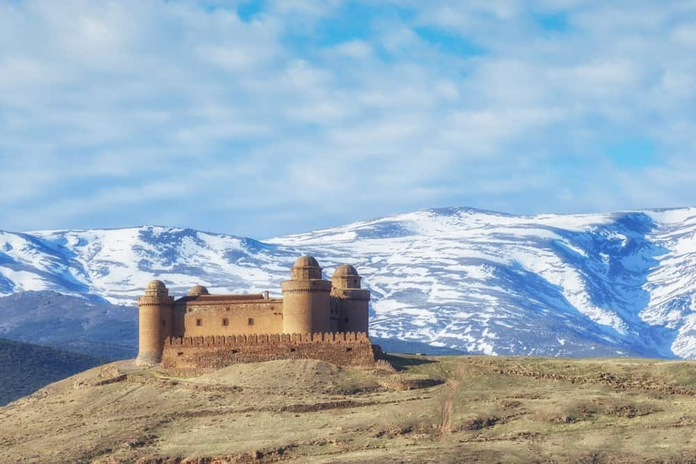 Concentric castle in an isolated isolation with the snowy mountains on the background.