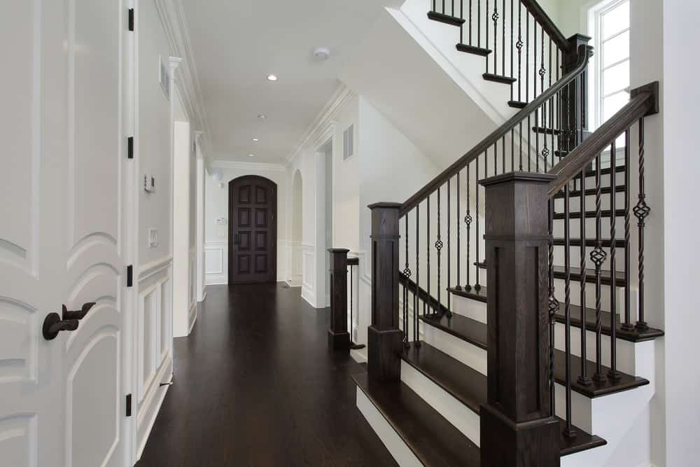 Dark wood and white staircase in foyer