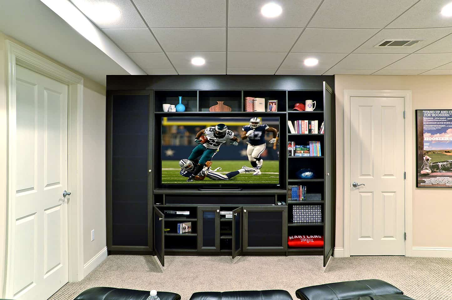 Built-in entertainment system for a wall mounted TV.