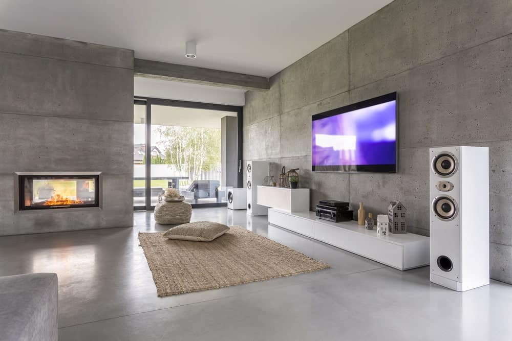 Spacious modern living room with concrete walls.