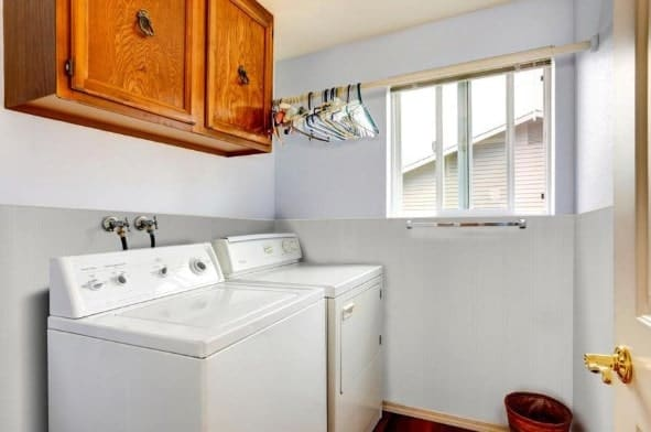 Laundry room with fiberglass reinforced panels.