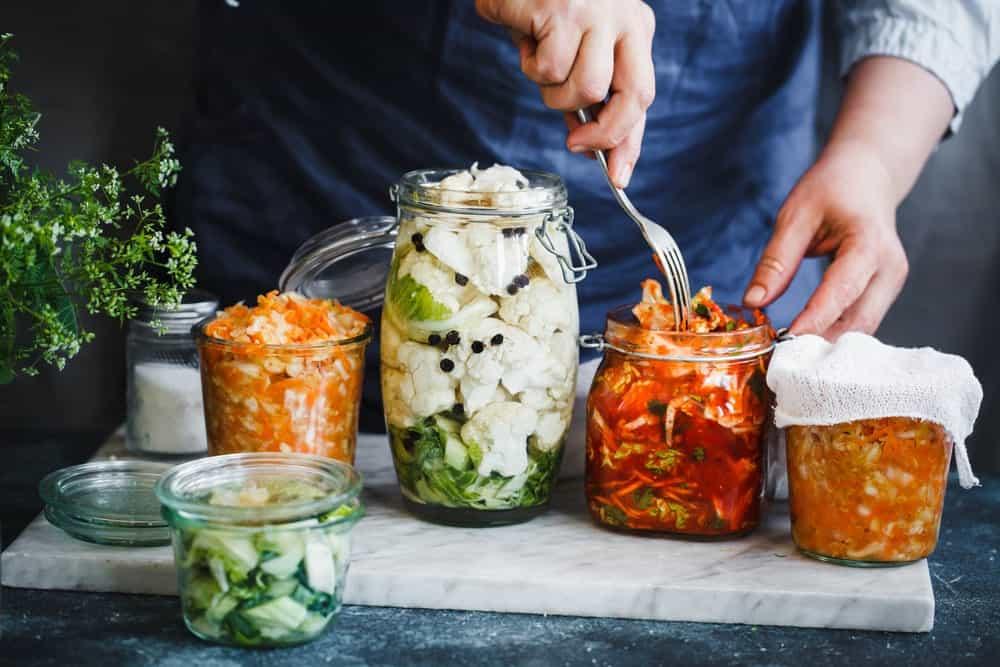 Preserved vegetables stuffed inside glass jars