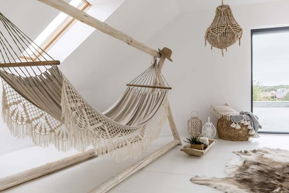 Hammock in a white attic bedroom.