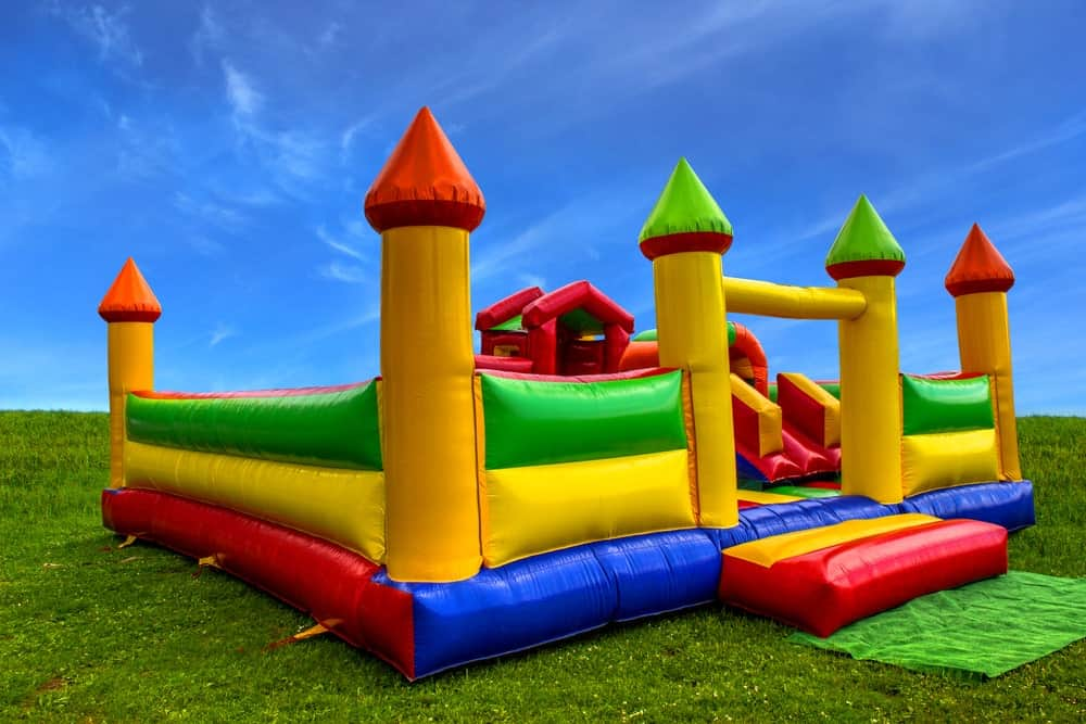 Multi-colored inflatable bouncy castle.