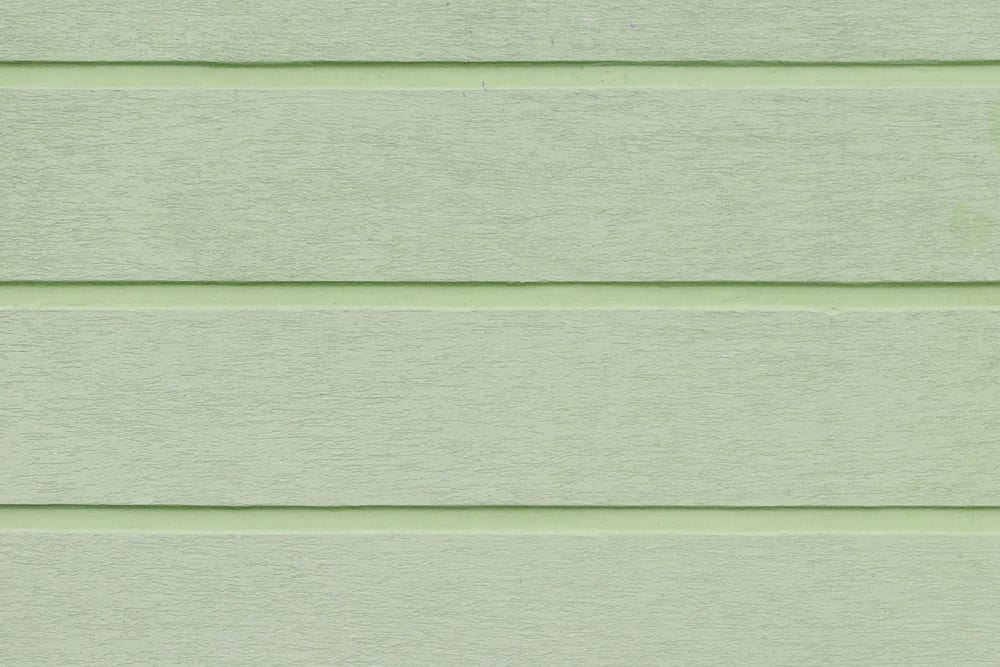 Texture of green-painted plaster