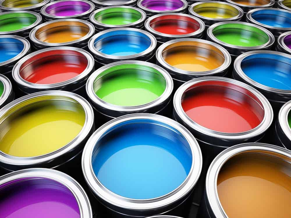 Open cans of paint.