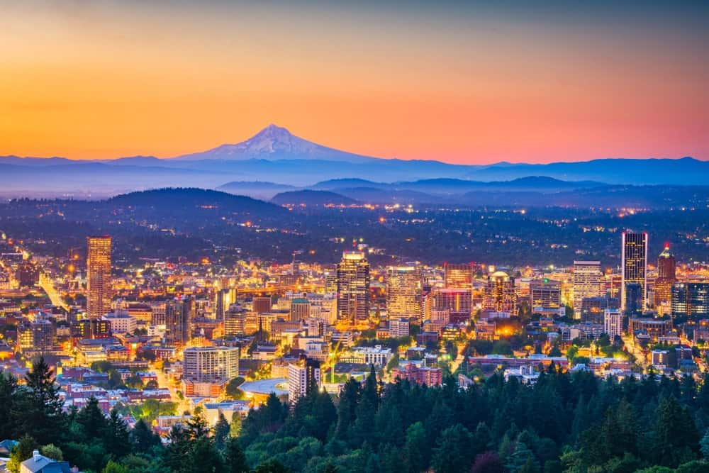 Skyline of Portland, Oregon at dusk with Mt. Hood at a distance.